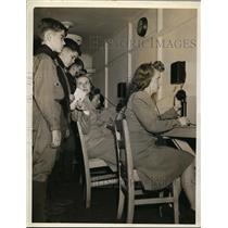 1948 Press Photo Report Center Women's on Phone and Boy Scout.  - nee60462
