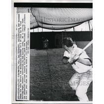 1957 Press Photo Ted Kazanski Philadelphia 2nd basemant & a batting machine