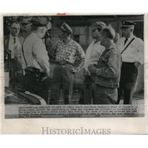 1957 Wire Photo Police Muller watches the investigation of the dynamite bombing