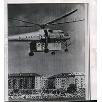1961 Wire Photo Soviet Navy Helicopter sunggles a house to its fuselage