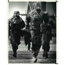 1990 Press Photo The reservists run in M.O.P.P. 4 with the protective gear