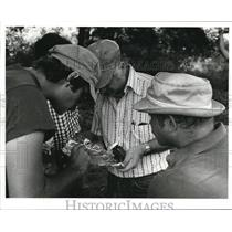 Press Photo Men are Looking at the Object in a Piece of Foil - cva73790