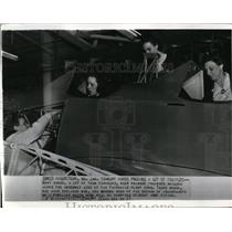 1941 Wire Photo Females making adjustments in trainers at Fairchild plant