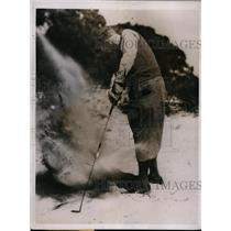 1935 Press Photo A golfer hitting out from a sandtrap on a course - nes40063