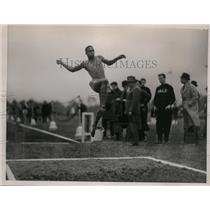 1923 Press Photo Ben Johnson in long jump event at a track meet - nes40264