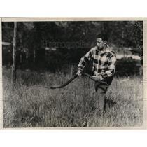 1926 Press Photo Welterweight title contender George Levine cutting grass