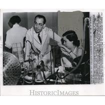 Wire Photo Dr. Salk supervises a laboratory progress on the Polio vaccine
