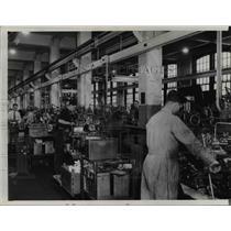 1941 Press Photo Interior of the Warner & Swaseu Co. shows men at work.