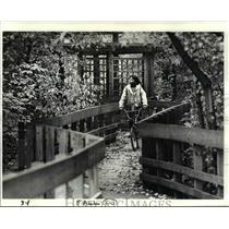 1987 Press Photo Vernordo Froando rides a bike at Shaker Heights Ohio