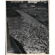 1948 Press Photo Crowd Leaving stadium going up W.3rd gate A. - cva92732