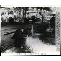 1942 Wire Photo Acetylene torches speed assembly lines in Chrygler Plymouth