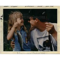 1997 Press Photo Young Girl and Dad with a Fish in Oregon - orb15556
