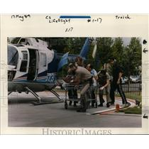 1989 Press Photo Victim in Recent Car Accident Brought by Life Flight Helicopter