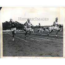 1936 Press Photo James Hucker wins 200 meter hurdles at National AAU in NJ