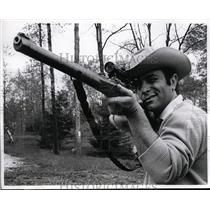 1969 Press Photo Corbett Monica with rifle on his PA horse ranch hunting bear