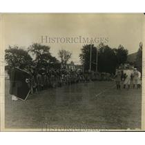 "1925 Press Photo Dartmouth Football team practices using ""bucking harness"""