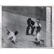 1944 Press Photo A's Jacobs slides safe at 2nd vs Runnels of Senators