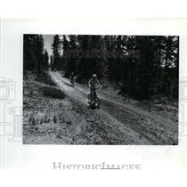 1993 Press Photo The Robert Alexander Jr bikes down trail heading for waterfalls
