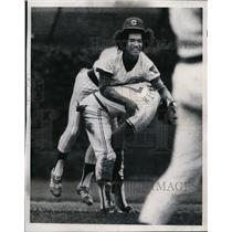 1975 Press Photo Cubs Dave Rosello leapfrogs Cardinal Reggie Smith