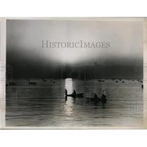 1938 Press Photo Sunrise over Seattle's Elliott Bay & Ben Paris Fishing Derby
