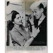 1951 Press Photo Gladys Kassabian Stamped Samuel Long In The Forehead