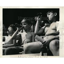 1944 Press Photo Kids watching a baseball game from the stands and drinking soda