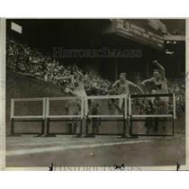 1927 Press Photo Three men running the 110 meter hurdles race - net04841