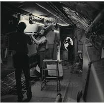 1984 Press Photo Todd Douma, Mick Raub prepare interior of a Midwest Express jet