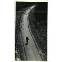 1991 Press Photo A bicyclist pedals down the bike path - mja07059