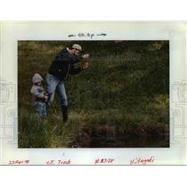 1998 Press Photo Young Boy Fishing with His Dad - orb15558