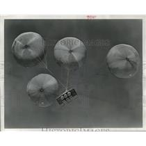 1955 Press Photo Four parachutes and six new barrel shaped rubber cushions