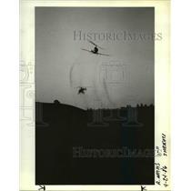 1986 Press Photo A Helicopter Sprays Fields To Kill Gypsy Moths - orb00187