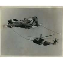 1967 Press Photo Air force helicopter refueled in flight from tanker plane