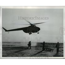 1954 Press Photo Expedition members await helicopter for supplies in the Arctic