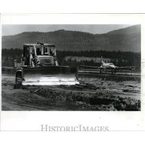 1993 Press Photo Bulldozer rips up one of two runways at Coeur d' Alene Airport