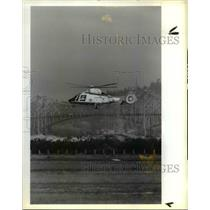 1988 Press Photo New Aerospatiale H-65 Helicopter Hovers Over North Bend Oregon