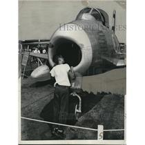 1949 Press Photo Boy looks at F-96 plane at National Air Fair at O'Hare Field