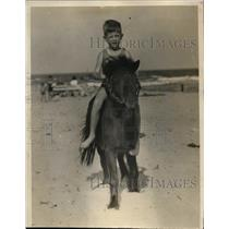 1929 Press Photo Miami Beach Energy Saving Youngster Plays On Sand With Pony
