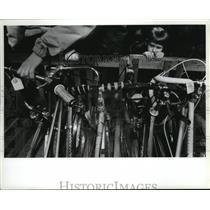1992 Press Photo Brandon Robar checks bike to be auctioned by Spokane Police