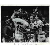1989 Press Photo Brad Komminsk is swarmer by his teammates at the plate.