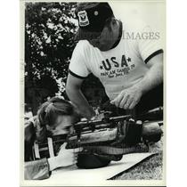 Press Photo Deena Wigger gets shooting lesson from her father Lones Wigger.
