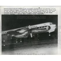 1961 Press Photo Damaged Eastern Airlines Electra Plane Landing at Logan Airport