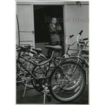 1994 Press Photo Autumn Coutts waits for customers at Quinn's Wheel Rental