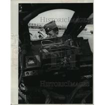 1963 Press Photo an officer checks the wreck University of Southern California