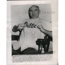 1954 Press Photo Wally Moses tries on a Philadelphia Phillies uniform for size.