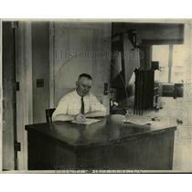 1926 Press Photo Tom Kelly, livestock & produce market editor at is desk