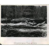 1963 Press Photo The Wolfe river tests the skills of two canoeists. - mja37891