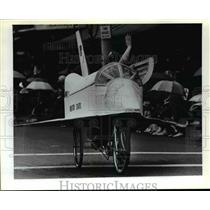 1981 Press Photo Patrick Sherman waves as he pilots three-wheeled space shuttle