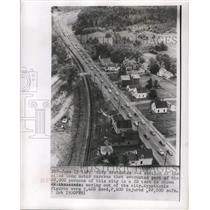 1955 Press Photo The long motor caravan of an evacuating city in a CD test