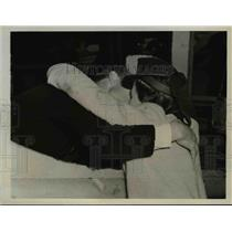 1941 Press Photo Walter Giles hugs Miss Evelyn Tank in Boston, Mass.